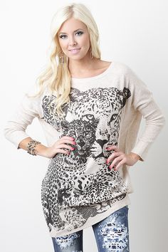 Show off your love for fashion with the Majestic Leo Top. This top features soft stretch knit with leopard graphic at front, rhinestone accents, round neckline, dropped shoulders, quarter-length dolman sleeves, and finished with ribbed hemline