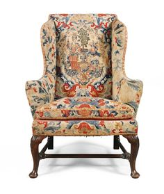A George I walnut and needlework upholstered wing armchair the needlework partially 18th century the backrest and seat with central needlework panels worked in petit point, both panels within later gros point foliate needlework, on cabriole legs joined by stretchers