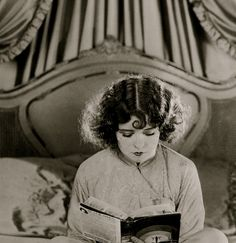 Clara Bow reading in bed (quite suggestive then I should imagine!)