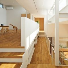 "Open-plan house in Japan by MAMM Design features mezzanine ""street"""
