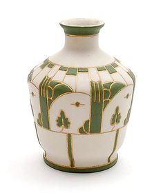 Bisquit-porcelain vase with deepened gold inlaid lines and with green porcelainsilt filled fields design Adolf le Comte executed by the Porceleyne Fles Delft / the Netherlands 1902