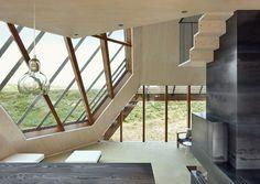 Die Fenster bieten einen atemberaubenden Ausblick über die Dünen der Insel