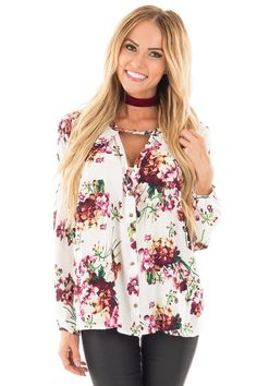 Lime Lush Boutique - Ivory Babydoll Top with Plum Floral Print and Keyhole Neckline, $39.99 (https://www.limelush.com/ivory-babydoll-top-with-plum-floral-print-and-keyhole-neckline/)