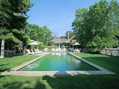 Hamptons living. Pool area inspiration. I love pools surrounded by grass.