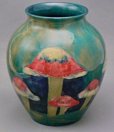 Moorcroft's talents soon saw him promoted to director of the art pottery department. Description from sylviapowell.com. I searched for this on bing.com/images