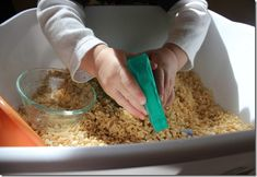Rice Krispies sensory bin! Cheap, edible and squirt with water and it will crackle!