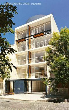 Residential building in Buenos Aires - Edificio bajo residencial estilo Contemporáneo en un barrio urbano.