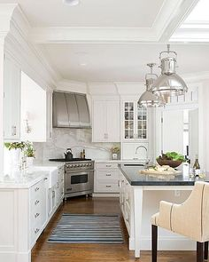Beautiful kitchen. Nice solution for the stove when your tight in space. @archdigest #kitchen #architecturaldigest #whitekitchen #white