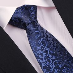 Men Polyester Silk Floral Embellished Casual Business Necktie.      Perfect size to wrap around your shirt collar.     Compact and stylish design will be nice to collocate with your suit and shirt.     Polyester silk material is great for durability and harmless for your skin.     Whether you're going for a laid back look or something more formal, such as wear in a dinner party and wedding, you can find that perfect look.