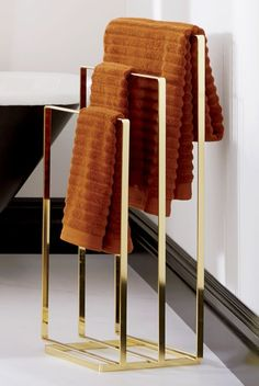 valet your terry. Brass-plated metal butler squared flat parks three bath towels off the wall. Smart hangout for blankets/throws in living/bedroom, too. Bathroom Towel Decor, Bathroom Colors, Bathroom Furniture, Antique Furniture, Bathroom Ideas, Bathroom Rack, Bathroom Curtains, Bath Decor, Plywood Furniture