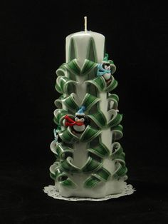 Check out this item in my Etsy shop https://www.etsy.com/listing/251560693/hand-carved-candle-green-and-white