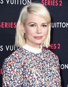 Michelle Williams with silvery, cool-toned platinum strands and a deep-side part, 2015