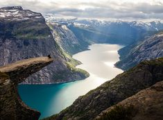 "Trolltunga is a piece of rock ""hanging"" horizontally out of the mountain about 700 meters above the Ringedalsvatnet in Skjeggedal close to Tyssedal by the Sørfjorden of the Hardanger Fjord in the municipality of Odda, Norway"