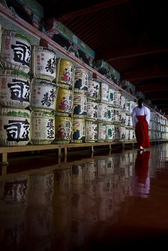 Japanese Sake barrels as offering and a priestess.