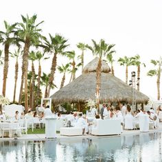 During the poolside cocktail hour, guests sipped on refreshing margaritas and Micheladas--a Mexican drink made with beer, lime juice, sauces, spices and peppers. from the album: A Swanky Beach Wedding in Cabo San Lucas, Mexico