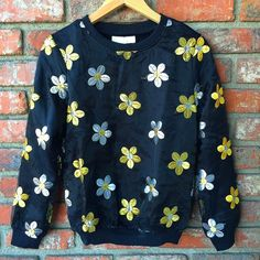 """Floral sweater Black, fully lined sweater with organza overlay and detailed, metallic gold and silver, floral stitching, cuffed arms and hem. New with tags. Measurement: bust- 17"""", sleeves - 23, length, 23"""", hem- 12 1/2"""". Sweaters"""