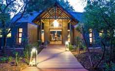 Nestled in the scenic Klaserie region in the Greater Kruger is AM Lodge – a luxurious, private oasis. The lodge is inspired by the colours and hues of the Lowv… South Africa Safari, Cultural Diversity, Game Reserve, Water Features, Lodges, Gazebo, National Parks, Villa, Outdoor Structures