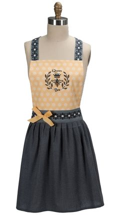 """Be the Queen of your Kitchen with pretty and cute Queen Bee women's Apron. This cute, colorful, embroidered, cotton apron features a gingham style skirt, a """"Queen Bee"""" designed embroidery on the front"""