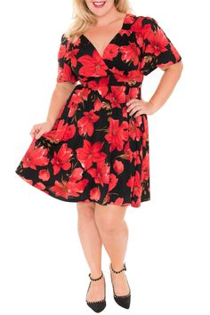 We love the retro feel of this new floral print as well as the shape! The Lizzy Dress in Redlily is an effortless way to make a serious style statement this Seeason. The timeless appeal of this poppy floral print is right on trend this season and is sure to make the Lizzy in Redlily a classic that will quickly become a staple part of your wardrobe.  Description: Flutter sleeve with Fit and Flare Design with a Full Skirt Color: Shades of red with tones of golden taupe and a splash of light…