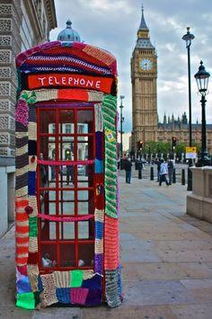 Yarn bombing (or yarnbombing, yarnstorming, guerrilla knitting, urban knitting or graffiti knitting) is a type of graffiti or street art that employs colorful Yarn Bombing, Guerilla Knitting, Red Brolly, Street Art, Street View, Instalation Art, Telephone Booth, Grafiti, Art Yarn