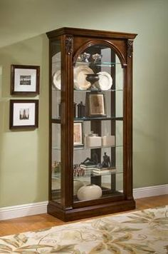 Encore Eight-Shelf Curio Cabinet in Fruitwood Brown | Philip ...