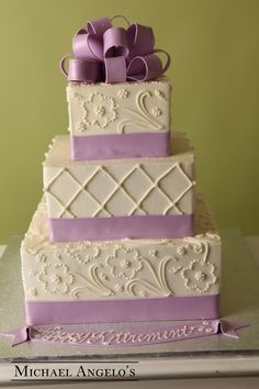 Floral Swirl #44Classic This cake is a three-tier square design with floral-like swirls made of buttercream on two layers. Lilac fondant ribbon was also added to each tier to create a nice border around the edges, a perfect way to add color to your wedding cake. Personalize it with any message you want!