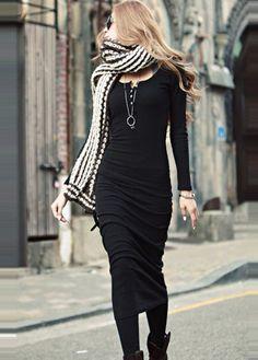 slim black midi dress.  chunky scarf and booties.