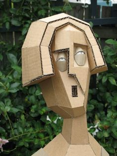 Sculpture...Amazing using waste cardboard often. Great inspiration for class of sculpture using recycled materials...focus on emotions, etc.. Excellent! Amazing artist!