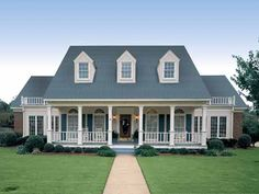 Gotta have a front porch! I would do stone and siding with different shutter colors.