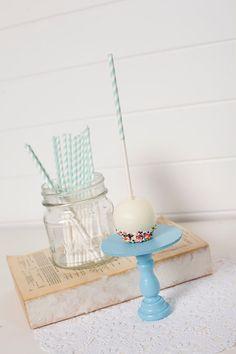 light aqua treat sticks; cute idea to dip the bottom of a cake ball or truffle in sprinkles