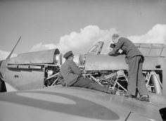 An RAF sergeant introduces Czech fitters to the inner workings of a Hurricane Mk I of No 310 Squadron RAF at RAF Duxford in October 1940. The gravity fuel tank in front of the instrument panel provided no form of protection for the pilot and was the cause of cockpit fires if ignited during combat. The Hurricane Rash was of such concern that Hawker was made to retrofit the fuselage tanks with a self-expanding rubber coating called Linatex.