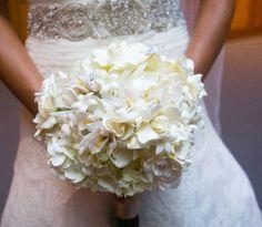 Bouquet of classic white gardenias, orchids, stephanotis and hydrangea