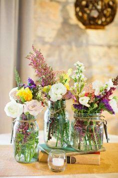 rustic colorful wildflowers mason jar wedding centerpiece / http://www.deerpearlflowers.com/cheap-mason-jar-wedding-ideas/