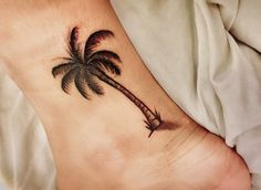 palm tree tattoo ; ankle tatto