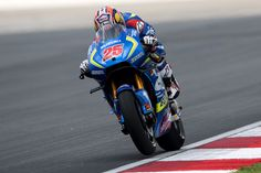 Maverick Vinales Photos Photos - Maverick Vinales of Spain and Team Suzuki ECSTAR heads down a straight during the  MotoGP Of Malaysia - Free Practice at Sepang Circuit on October 28, 2016 in Kuala Lumpur, Malaysia. - MotoGP of Malaysia - Free Practice
