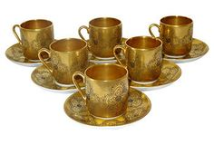 gold cups and saucers
