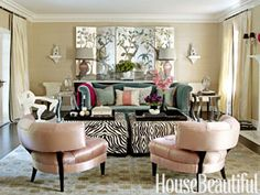 In this Beverly Hills living room, designer Martyn Lawrence Bullard choose Jean de Merry slipper chairs in Schumacher Sargent Blush silk taffeta.