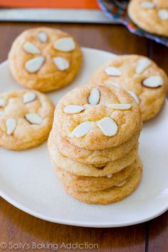 Easy Sand Dollar Cookies.  A soft and chewy homemade sugar cookie rolled into cinnamon and sugar and topped with sliced almonds.