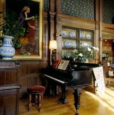 Wightwick Manor: The Great Parlour, with portrait of Mrs Nassau Senior by George Frederic Watts (1857-8). Note the 'Diagonal Trail' fabric, designed by J.H. Dearle for Morris & Co. on the walls. The formerhome of the Mander family, Wightwick has one of themost complete surviving Arts & Crafts interiors. The Manders mixed what they bought from the Morris & Co shop in London's Oxford Street with their own belongings and antiques. #William_Morris #Morris_and_Co #Wightwick_Manor