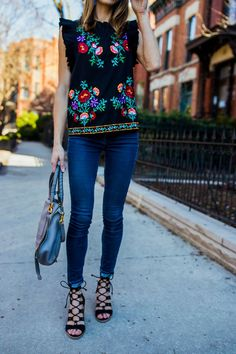 Spring Style // Beautiful embroidered top with jeans and strappy sandals.