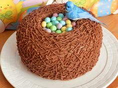 "Easter Bird Nest Cake, Adorable & very easy to create. This is made with Chocolate Buttercream Frosting, & also piped with a #4 tip, in small lengths, different directions to create the ""Nest"" look..."