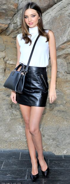 Miranda Kerr looks stunning in an outfit by Louis Vuitton consisting of a high neck top tucked into a leather mini skirt - Louis Vuitton Cruise 2016 Resort Collection show...x