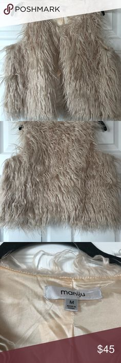 Trendy faux fur taupe/blush vest! Fun faux fur vest, size medium. Shorter length, but not quite cropped. Tag said color is taupe, but it definitely has blush undertones. Worn once, fabric didn't shed at all. Top has small clasp (shown). maniju Jackets & Coats Vests