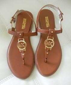 Let your style shine. The Sondra thong sandals by MICHAEL Michael Kors are crafted in luxe leather and feature a shining designer logo on the strap.  You Can Never Go Wrong When You Purchase Michel Kors. Summer End Bargain! Retails at $99.00. Item Details: Saffiano leather; Round open-toe thong s...