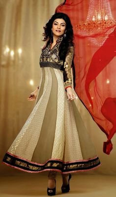 Bollywood Diva Sushmita Sen Georgette Anarkali Suit Make understated elegance your signature style as Bollywood diva Sushmita Sen as you don this cream and light brown shade faux georgette Anarkali suit. Kameez featuring embroidered yoke part. Alternate embroidered panels in front of kameez adds to the beauty. #GeorgetteAnarkaliSuit #TrendyPartyWearChuridarSuits