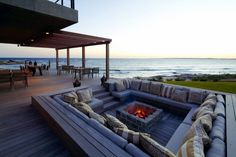 modern fire pit design square shape bangkirai wood deck sea view
