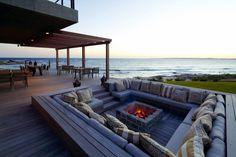 modern fire pit design square shape bangkirai wood deck sea view