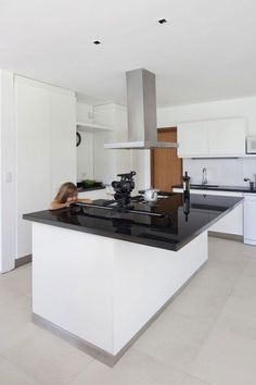 Architecture, Minimalist Kitchen Design For Small Spaces With Black And White Furniture Interior Color Decorating Ideas And Island With Marble Countertop Plus Cabinet With Door And Drawer ~ Grand Bell House by Andres Remy Arquitectos