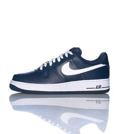 "NIKE ""Armory Navy"" Low top men's sneaker Lace closure Signature NIKE swoosh on side of shoe Padded tongue with logo Cushioned sole for ultimate comfort"