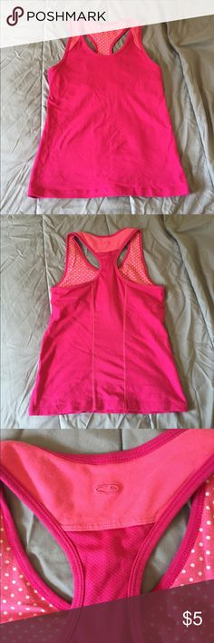 Pink Exercise Tank Top This tank has a built in bra and is pretty supportive! This is very gently worn so it is in great condition. It is a size medium dorm the Champion brand, but I feel as if it runs a little small. I offer a bundle discount, so please check out my other items. :) Champion Tops Tank Tops